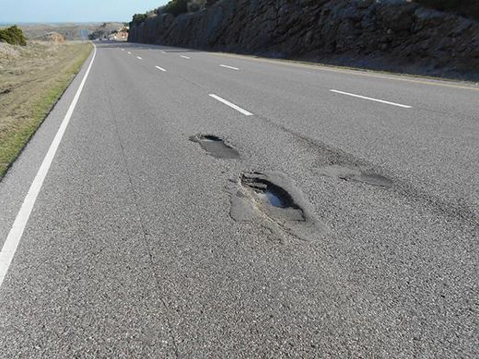 Photo -  Potholes like these on Interstate 35 in Murray County are popping up on highways all across Oklahoma. Photo provided    Photo provided.  -  Photo provided.