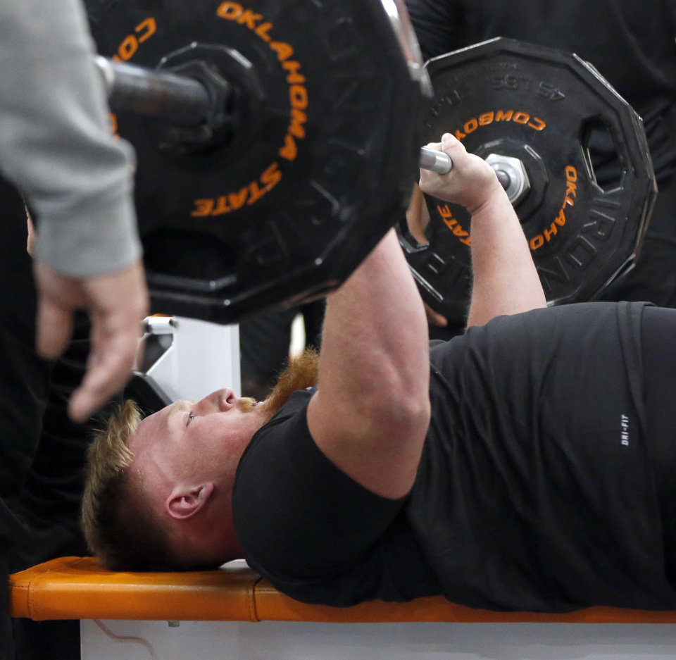 Photo - Oklahoma State offensive lineman Johnny Wilson bench presses during OSU Pro Day in Stillwater, Okla., Tuesday, March 10, 2020. [Nate Billings/The Oklahoman]