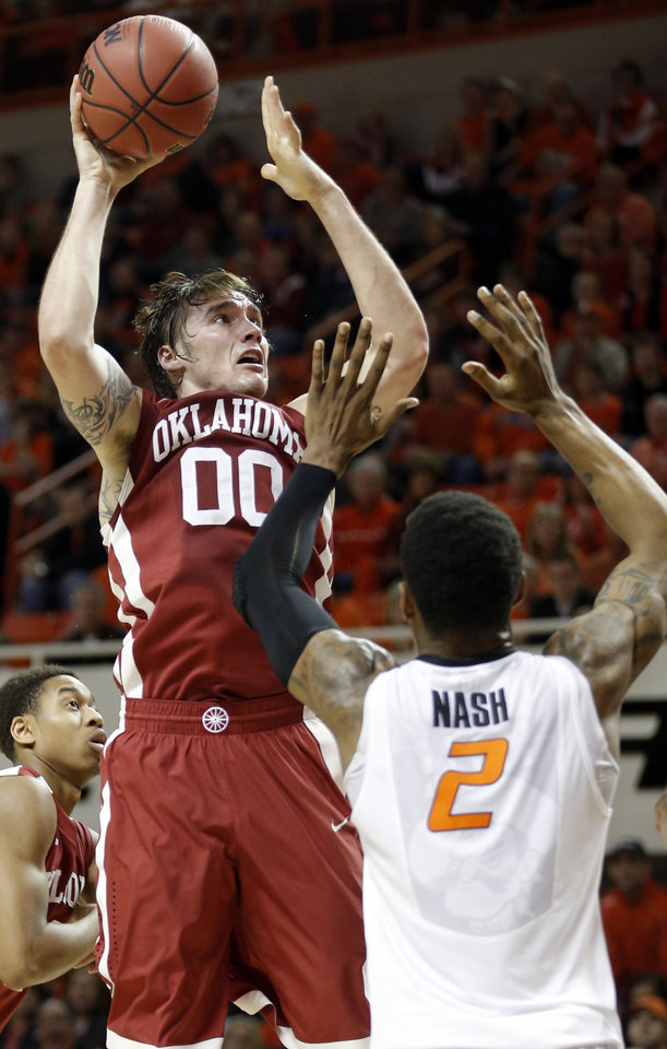 Photo - Oklahoma's Ryan Spangler (00) shoots over Oklahoma State's Le'Bryan Nash (2) during the men's Bedlam college game between Oklahoma and Oklahoma State at Gallagher-Iba Arena in Stillwater, Okla., Saturday, Feb. 15, 2014. Photo by Sarah Phipps, The Oklahoman