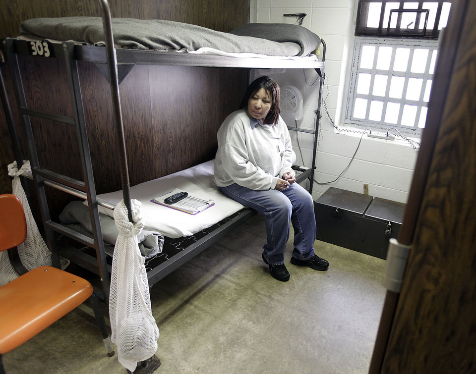 Lorrie Anderson sits on her bunk at Eddie Warrior Correctional Center Dec. 1, 2010. MIKE SIMONS/Tulsa World