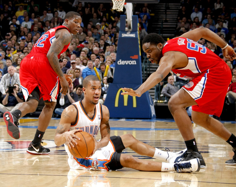 Oklahoma City's Eric Maynor (6) looks to pass between Los Angeles' Eric Bledsoe (12) and Ike Diogu (50) during the NBA basketball game between the Oklahoma City Thunder and the Los Angeles Clippers at the Oklahoma CIty Arena, Tuesday, Feb. 22, 2011.  Photo by Bryan Terry, The Oklahoman
