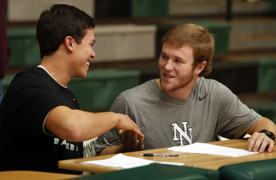 Photo - Baseball players D. J. Gasso, left, and Luke Jones sign letters of intent to play at Weatherford, Texas Junior College at a signing day assembly at Norman North High School on Wednesday, Feb. 6, 2013, in Norman, Okla.  Photo by Steve Sisney, The Oklahoman