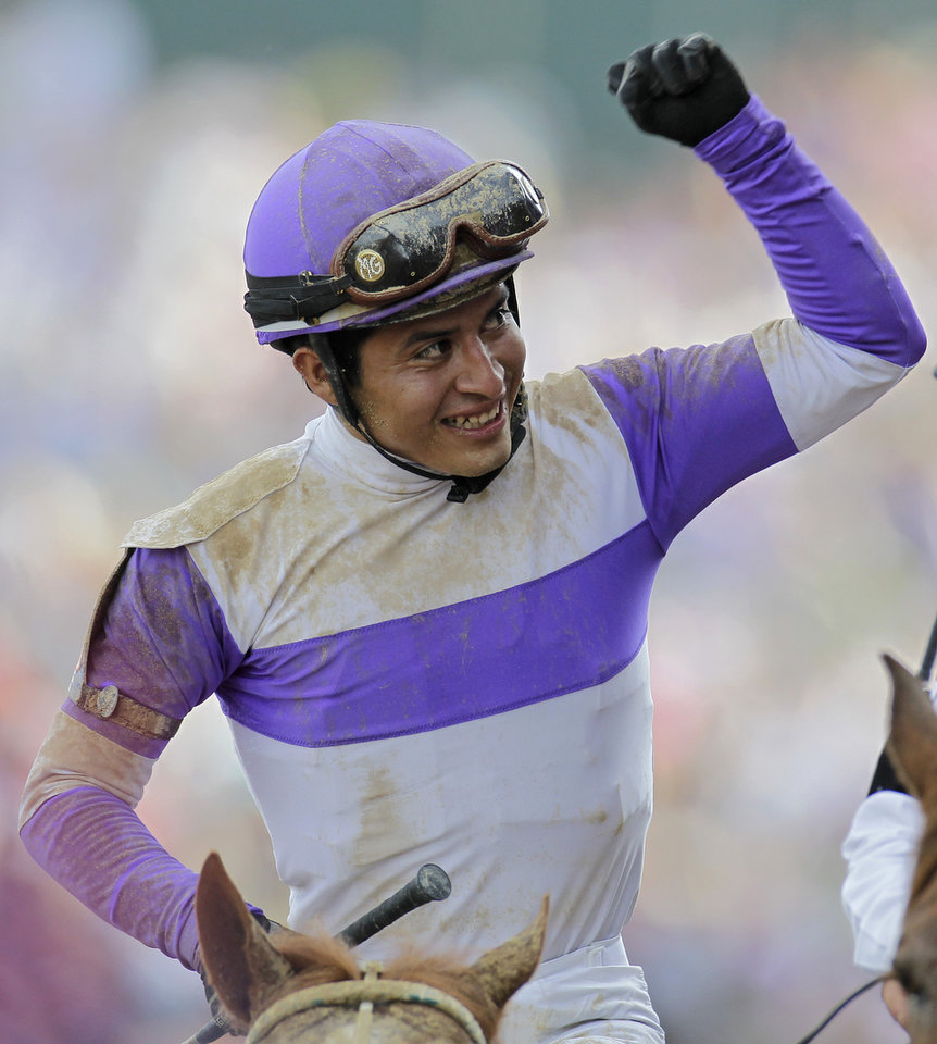 Photo - Jockey Mario Gutierrez reacts after riding I'll Have Another to victory in the 138th Kentucky Derby horse race at Churchill Downs Saturday, May 5, 2012, in Louisville, Ky. (AP Photo/Darron Cummings) ORG XMIT: DBY218