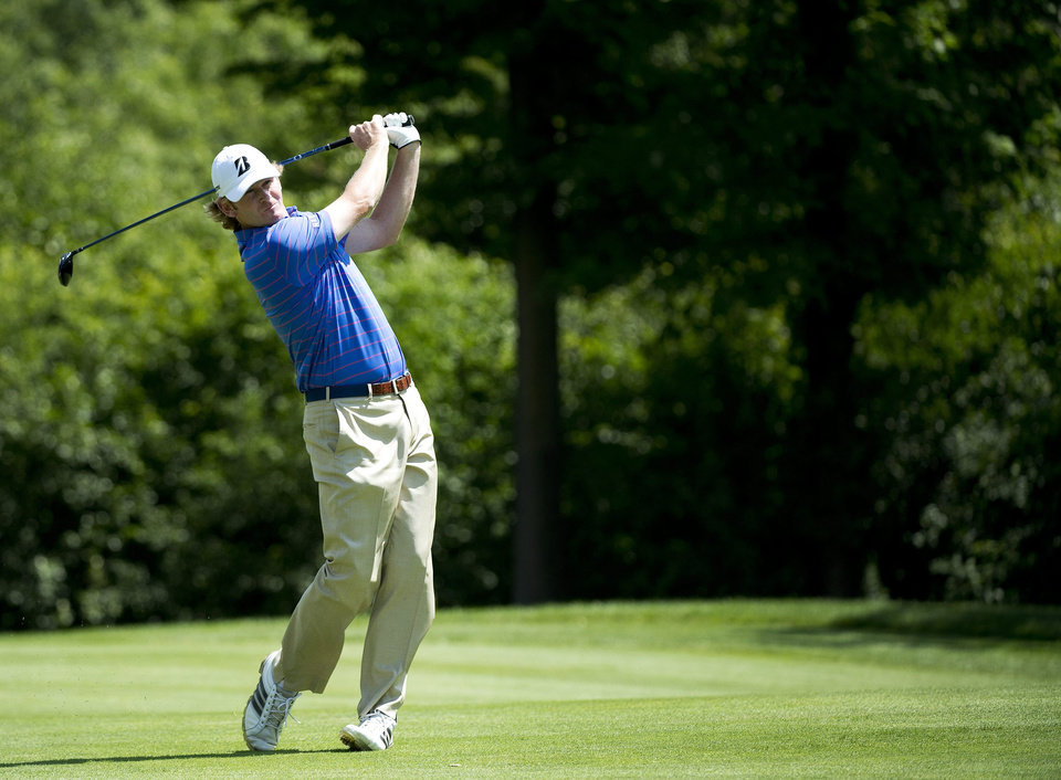 Photo - Brandt Snedeker of the Unites States watches his approach shot on the second hole during final round play at Glen Abbey at the Canadian Open in Oakville, Ontario, on Sunday, July 28, 2013.  (AP Photo/THE CANADIAN PRESS/Nathan Denette)
