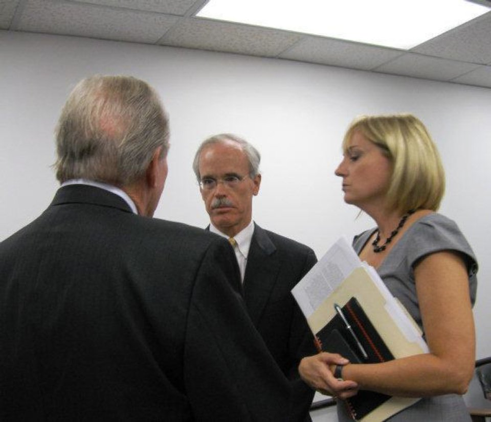 Developer Chuck Wiggin, center, visits with Urban Renewal attorney Dan Batchelor, left, and director Cathy O'Connor. <strong>Steve Lackmeyer</strong>