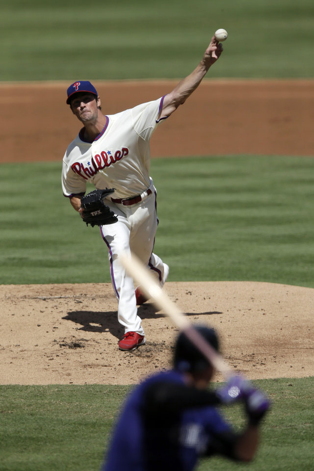 Photo -   Philadelphia Phillies' Cole Hamels pitches against Colorado Rockies' Andrew Brown in the second inning of the first game of a baseball doubleheader on Sunday, Sept. 9, 2012, in Philadelphia. (AP Photo/Matt Slocum)