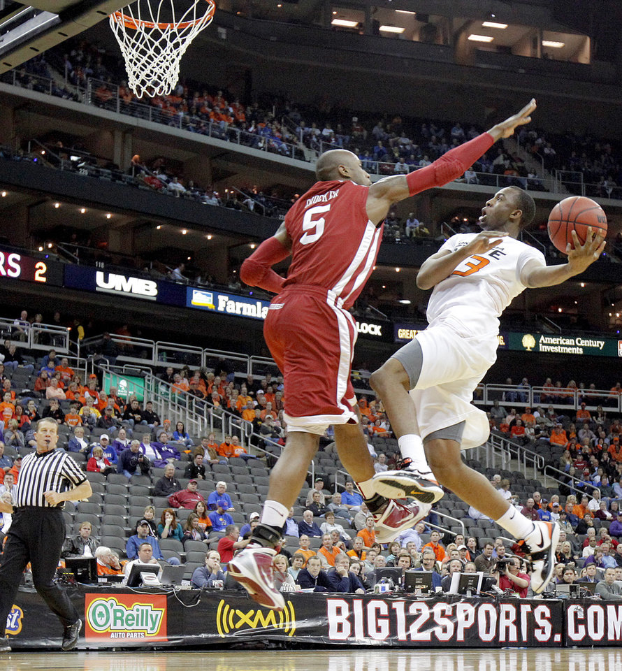 OSU\'s James Anderson goes to the basket past OU\'s Tony Crocker in the first half of the college basketball game during the men\'s Big 12 Championship tournament at the Sprint Center on Wednesday, March 10, 2010, in Kansas City, Mo. Photo by Bryan Terry, The Oklahoman