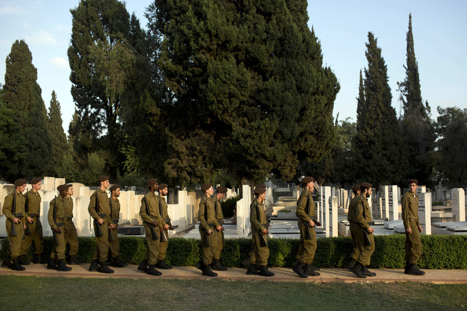 Photo - Israeli soldiers march during the funeral of Sgt. Sean Mondshane at a cemetery in Tel Aviv, Israel, Tuesday, July 22, 2014. Mondshane was killed in fighting in the Gaza Strip on Sunday. (AP Photo/Oded Balilty)