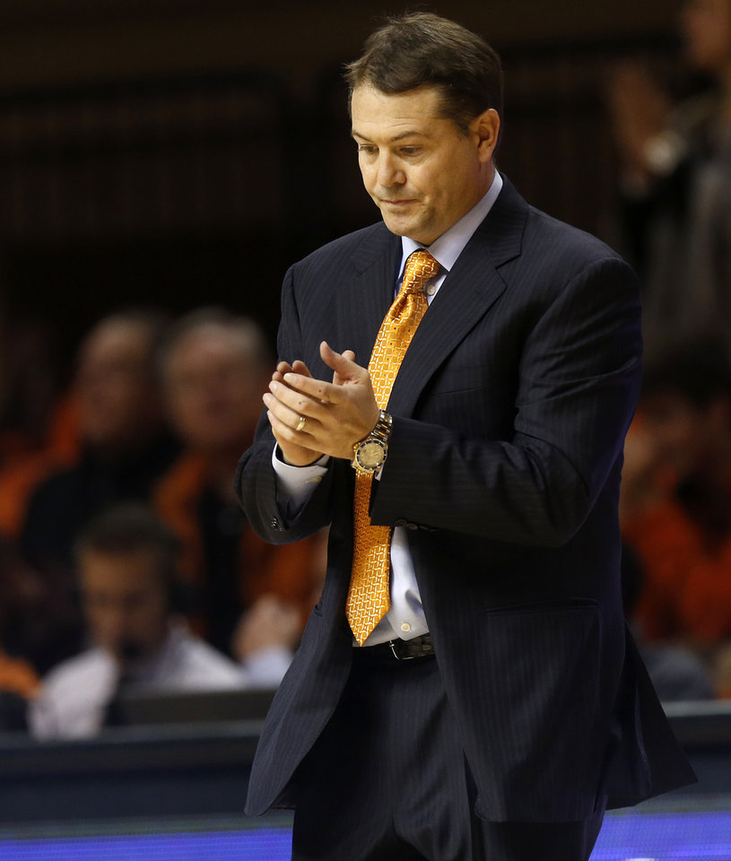 Photo - OSU coach Travis Ford walks on the court for a timeout in the second half during a men's college basketball game between Oklahoma State and Missouri State at Gallagher-Iba Arena in Stillwater, Okla., Saturday, Dec. 5, 2015. Missouri State won 64-63. Photo by Nate Billings, The Oklahoman