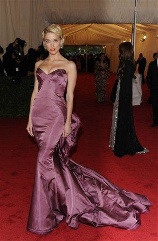 Photo - Amber Heard arrives at the Metropolitan Museum of Art Costume Institute gala benefit, celebrating Elsa Schiaparelli and Miuccia Prada, Monday, May 7, 2012 in New York. (AP Photo/Evan Agostini)