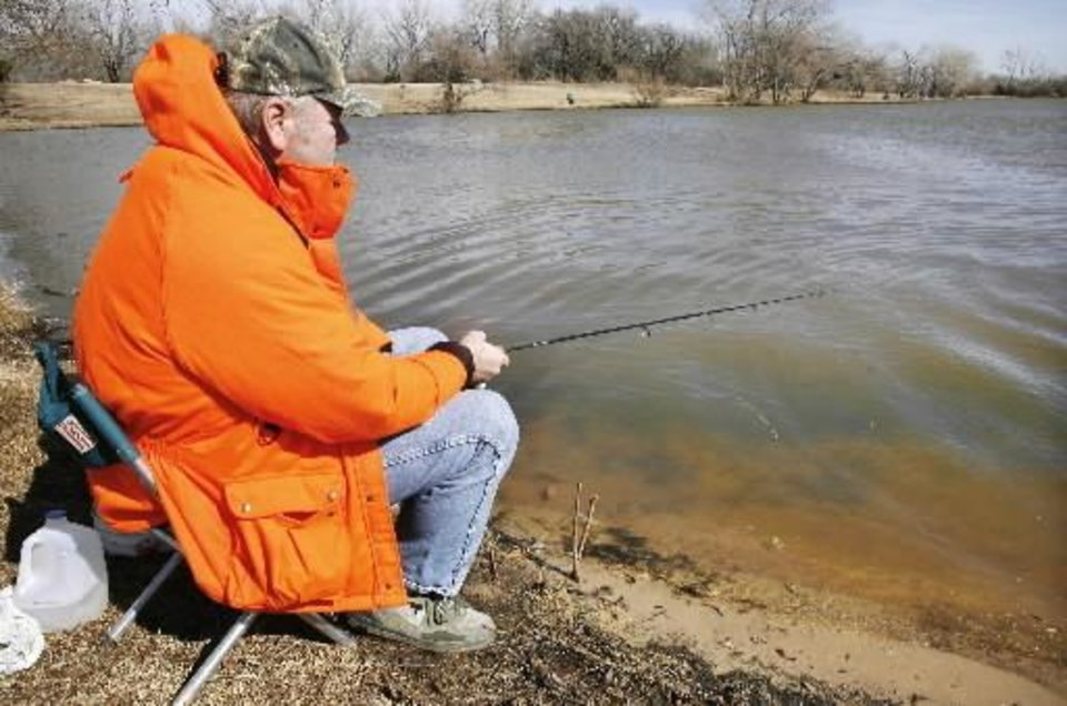 Mike Miller, Okla. City, fishing for rainbow trout in the  lake at  Dolese  Youth  Park, NW 50 and Meridian, in Oklahoma City Thursday, Feb. 14, 2008. BY PAUL B. SOUTHERLAND
