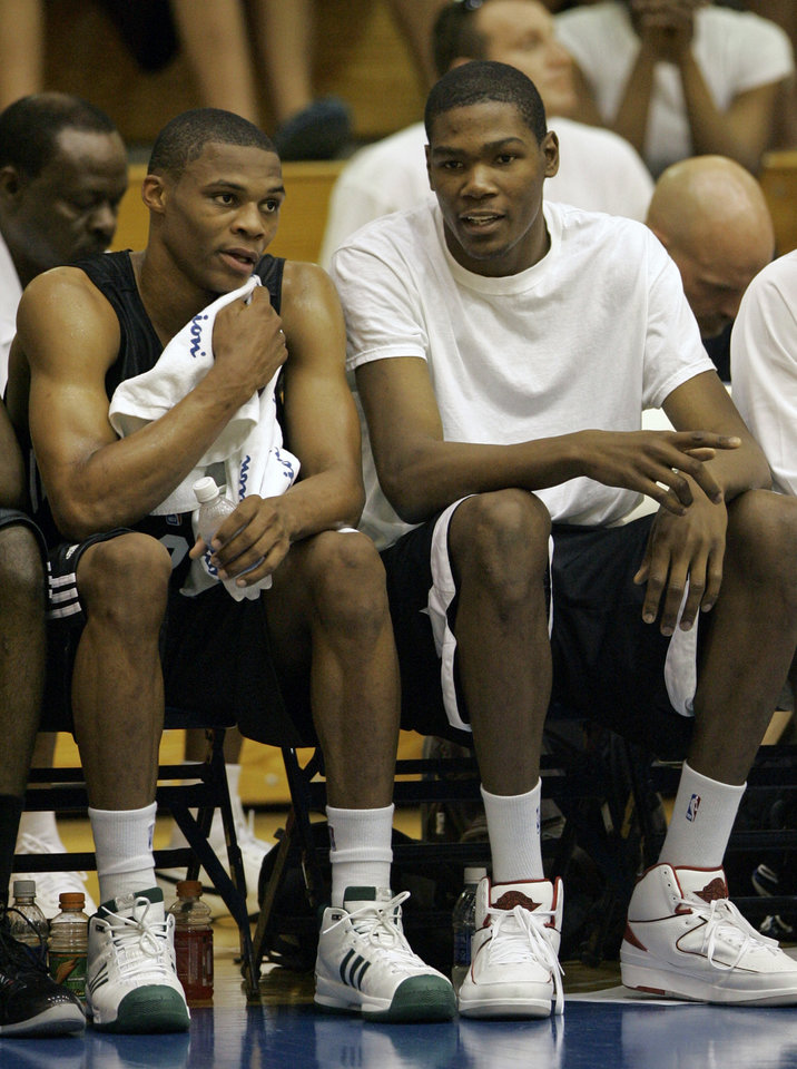 Photo - OKC NBA, FORMER SEATTLE SUPERSONICS, SONICS BASKETBALL TEAM: Russell Westbrook, left, and Kevin Durant  of the Oklahoma City NBA team,  watch their teammates play the Indiana Pacers during an NBA summer league basketball game in Orlando, Fla., Monday, July 7, 2008. (AP Photo/John Raoux) ORG XMIT: FLJR102