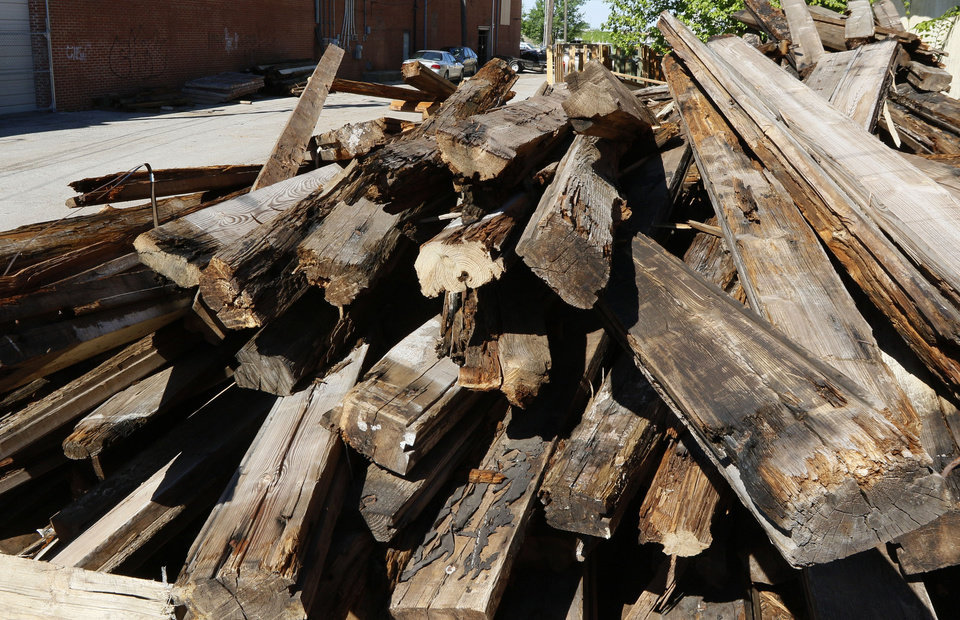 Photo - This stack of reclaimed wood will eventually be re-purposed into tables and other furniture at