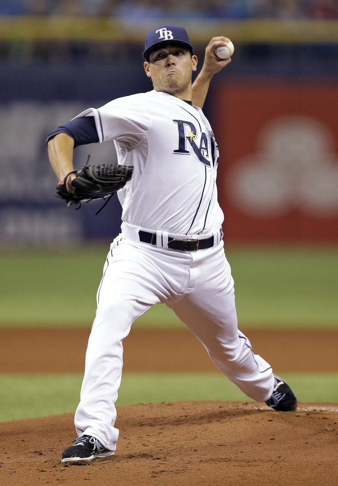 Photo - Tampa Bay Rays starting pitcher Matt Moore delivers to Toronto Blue Jays' Melky Cabrera during the first inning of a baseball game Wednesday, April 2, 2014, in St. Petersburg, Fla. (AP Photo/Chris O'Meara)