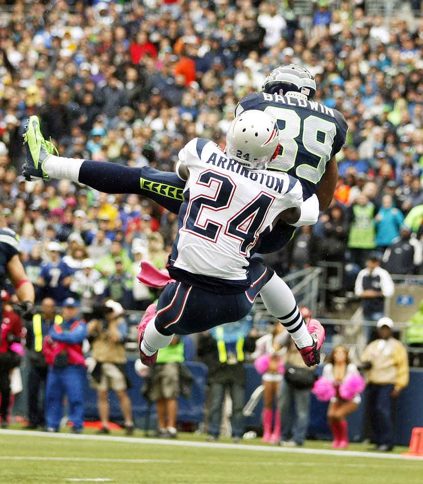 Photo -   Seattle Seahawks' Doug Baldwin (89 )makes a catch for a touchdown as New England Patriots cornerback Kyle Arrington (24) tries to defend in the first half of an NFL football game, Sunday, Oct. 14, 2012, in Seattle. (AP Photo/John Froschauer)