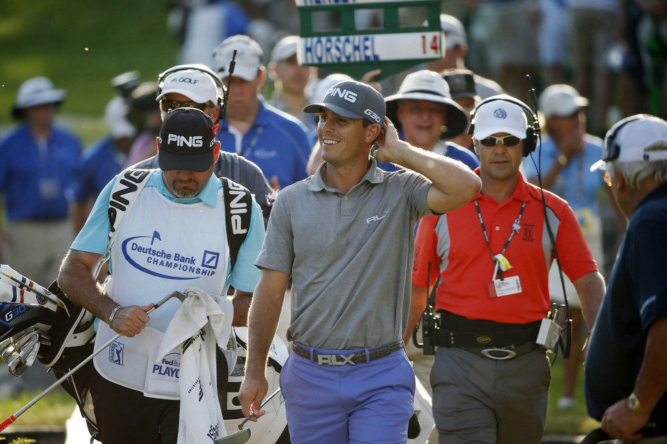 Photo - Billy Horschel, center, walks on to the 18th green during the final round of the Deutsche Bank Championship golf tournament in Norton, Mass., Monday, Sept. 1, 2014. (AP Photo/Michael Dwyer)