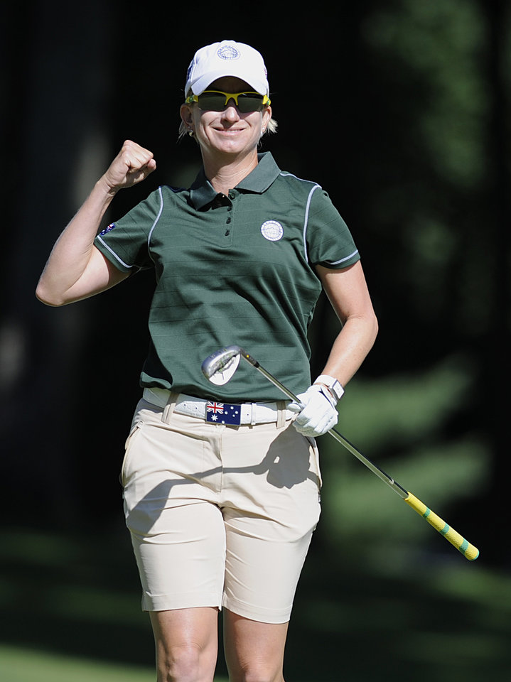 Photo - Karrie Webb, of Australia, reacts after holing out for birdie on the first hole during the second round of the International Crown golf tournament Friday, July 25, 2014, in Owings Mills, Md. (AP Photo/Gail Burton)