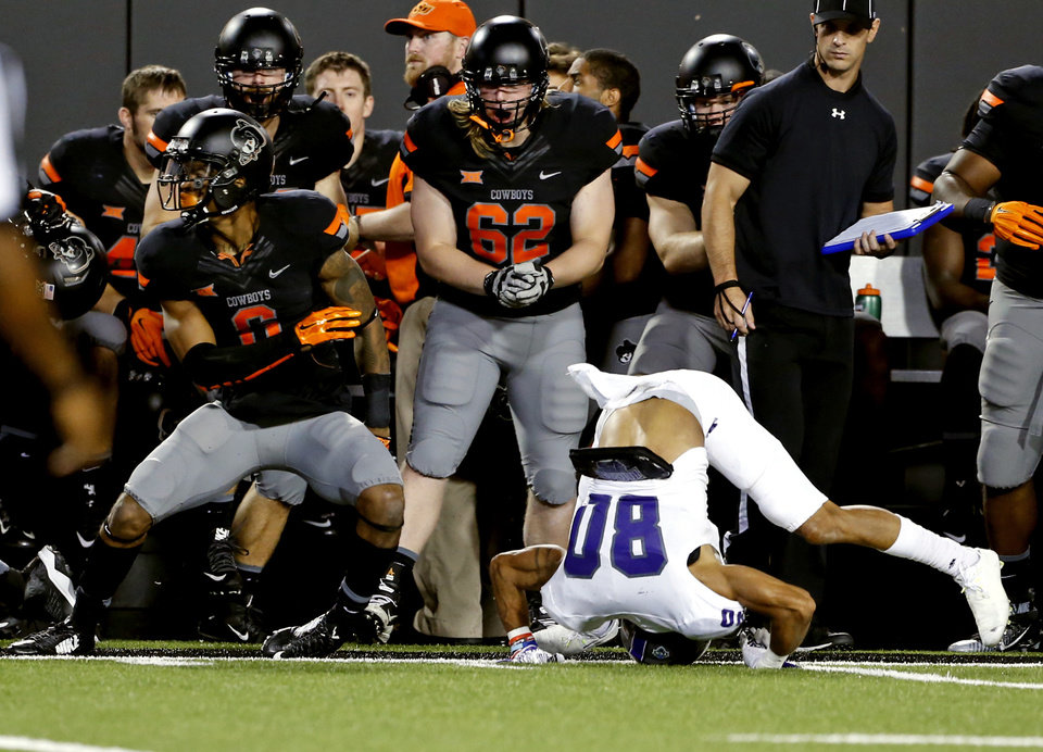 Photo - Oklahoma State's Ashton Lampkin (6) breaks up a pass intended for Central Arkansas' Blake Gardner (80) during the second half of the college football game between the Oklahoma State Cowboys (OSU) and the Central Arkansas Bears at Boone Pickens Stadium in Stillwater, Okla., Saturday, Sept. 12, 2015. Photo by Steve Sisney, The Oklahoman
