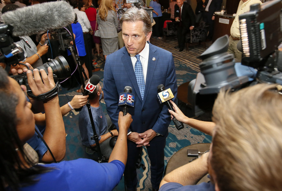 Photo - Attorney General Mike Hunter talks to the media at his watch party at the Renaissance Waterford Oklahoma City Hotel in Oklahoma City, Tuesday, June 26, 2018. Photo by Nate Billings, The Oklahoman