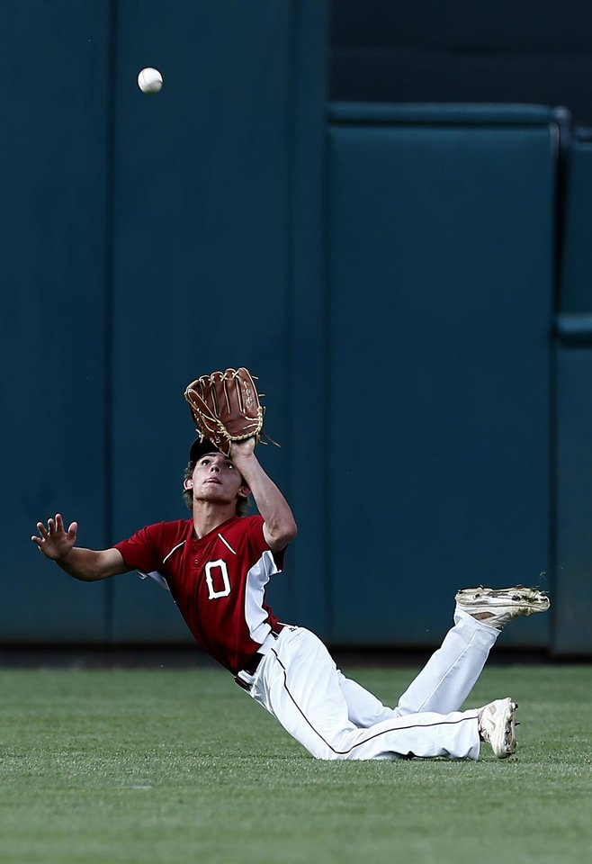 Photo - Dewey's Hunter Brewer tries to grab a fly ball during the class 4A state baseball championship game between Tuttle and Dewey at the Chickasaw Bricktown Ballpark in Oklahoma City, Saturday, May 17, 2014. Photo by Sarah Phipps, The Oklahoman