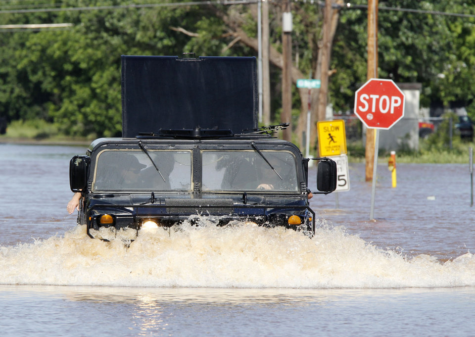 An Oklahoma County Sheriff's Dept. Humvee rescues residents from a flooded mobile home park off of Air Depot Blvd. between NE 10th and NE 23rd St. in Midwest City, OK, Saturday, June 1, 2013, after up to eight inches of rain fell during the previous 24 hours. Photo by Paul Hellstern, The Oklahoman