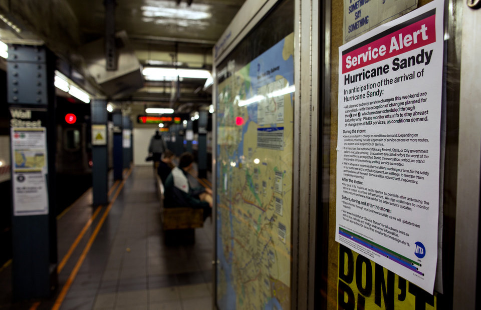 Photo -   A sign informs subway riders of changes in service in the hours before the arrival of Hurricane Sandy in New York Sunday, Oct. 28, 2012. Areas in the Northeast Region prepared Sunday for the arrival of the hurricane and a possible flooding storm surge. (AP Photo/Craig Ruttle)