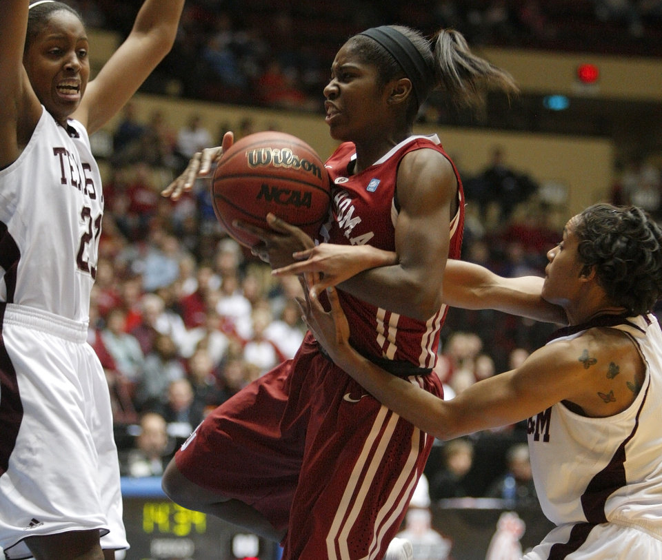 OU's Aaryn Ellenberg (3) goes to the basket between Texas A&m's Adaora Elonu (21), left, and Sydney Carter (4)during the women's college basketball Big 12 Championship tournament game between the University of Oklahoma and Texas A&M in Kansas City, Mo., Friday, March 11, 2011.  Photo by Bryan Terry, The Oklahoman