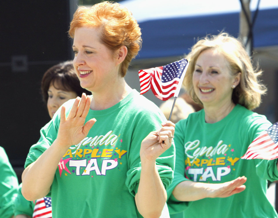 Lee Ann Finn, left, and others with the Lynda Tarpley School of Dance perform a patriotic tap number during the 2011 Paseo Arts Festival on Saturday. Photo by Steve Sisney, The Oklahoman Archives <strong>STEVE SISNEY - THE OKLAHOMAN</strong>