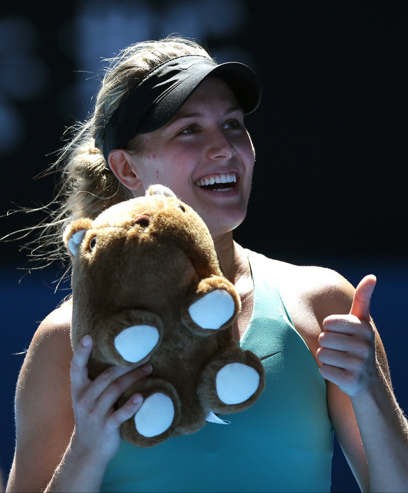 Photo - Eugenie Bouchard of Canada, holding stuffed doll of wombat, celebrates after defeating Ana Ivanovic of Serbia during their quarterfinal at the Australian Open tennis championship in Melbourne, Australia, Tuesday, Jan. 21, 2014. (AP Photo/Aaron Favila)