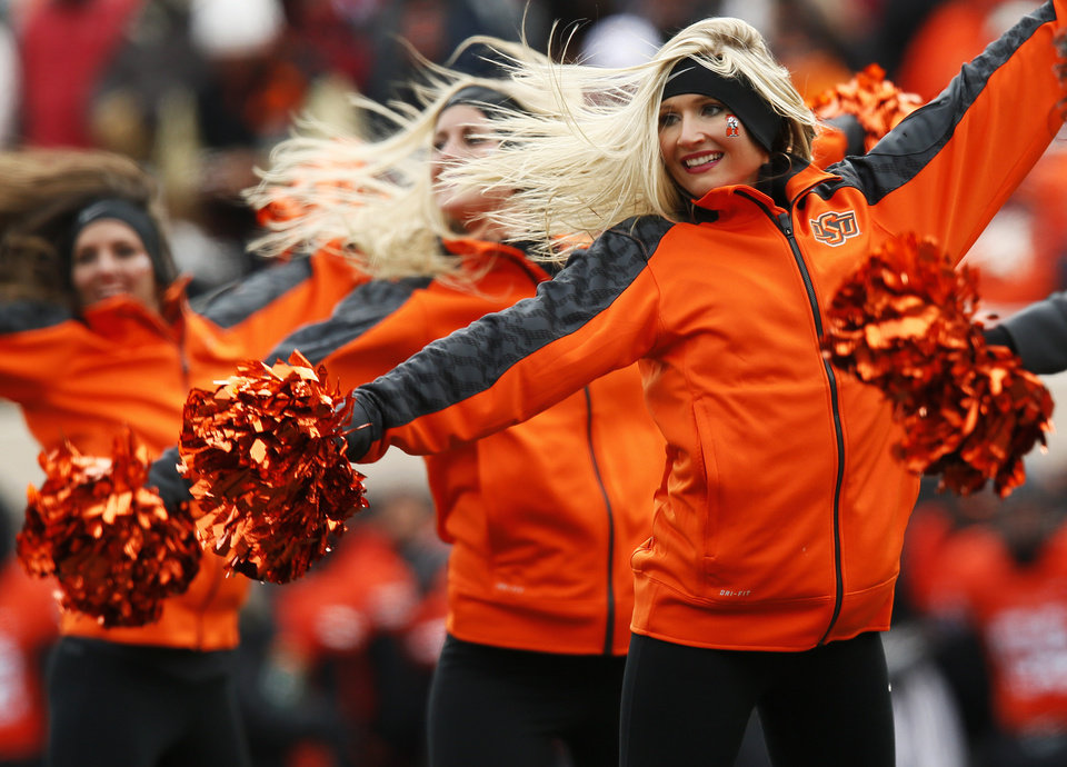 Photo - The OSU pom squad performs during the Bedlam college football game between the Oklahoma State University Cowboys (OSU) and the University of Oklahoma Sooners (OU) at Boone Pickens Stadium in Stillwater, Okla., Saturday, Dec. 7, 2013. Photo by Nate Billings, The Oklahoman
