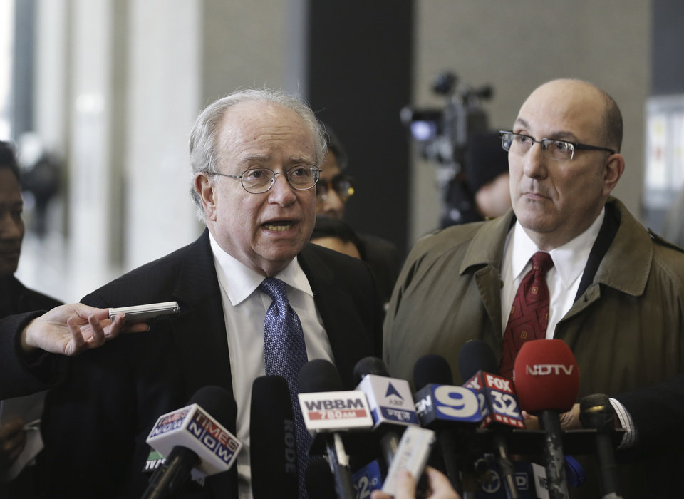 John Theis, left, and Robert Seeder, defense attorneys for David Coleman Headley, speak with reporters at the federal building in Chicago, Thursday, Jan. 24, 2013, after Headley, 52,, was sentenced to 35 years in prison for the key role he played in a 2008 terrorist attack on Mumbai that has been called India's 9/11. (AP Photo/M. Spencer Green)