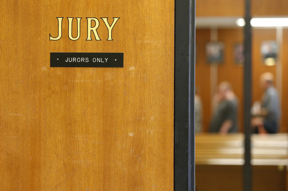 Photo - Potential jurors line up inside the jury assembly room in the Oklahoma County courthouse on Friday.  Bryan Terry - THE OKLAHOMAN