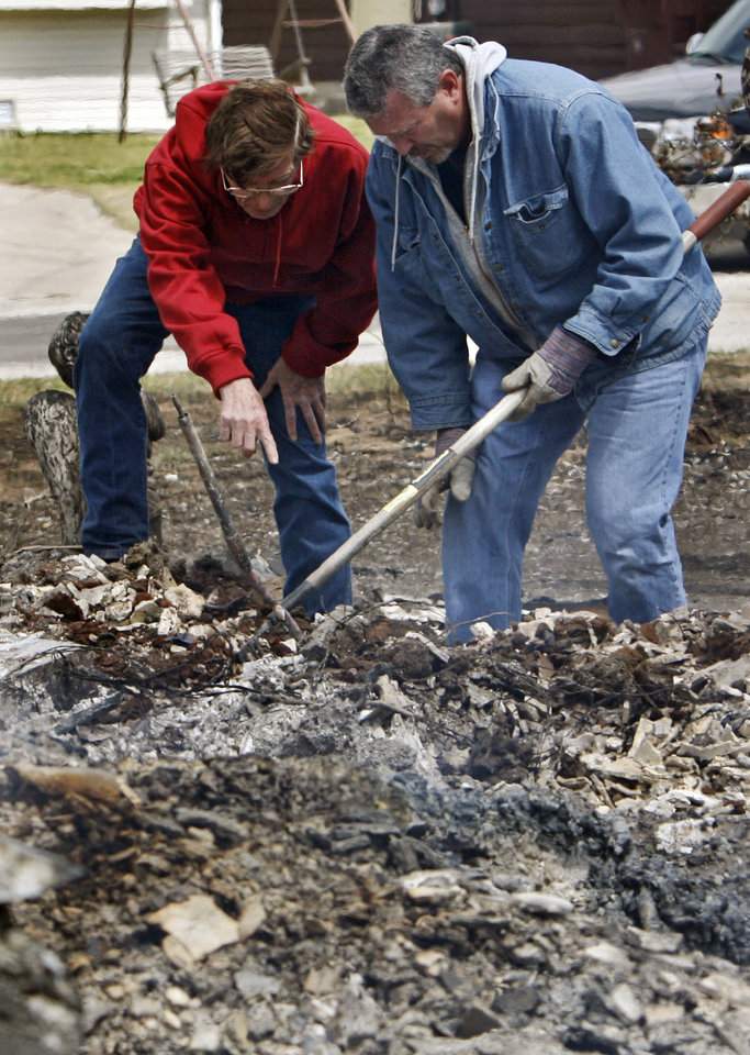 Residents dig through debris as they look for salvageable remains from a house that was destroyed by wildfires on Friday, April 10, 2009, in Choctaw, Okla.  Photo by Chris Landsberger, The Oklahoman