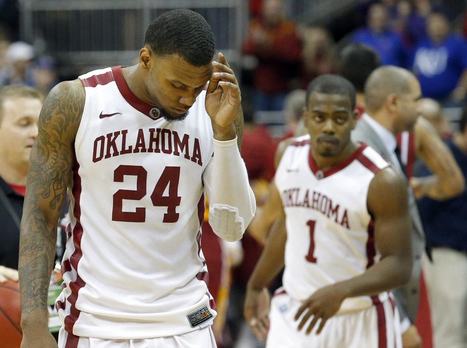 Photo - Oklahoma's Romero Osby (24)  and Sam Grooms (1) walk off the court after losing in the Phillips 66 Big 12 Men's basketball championship tournament game between the University of Oklahoma and Iowa State at the Sprint Center in Kansas City, Thursday, March 14, 2013. Photo by Sarah Phipps, The Oklahoman
