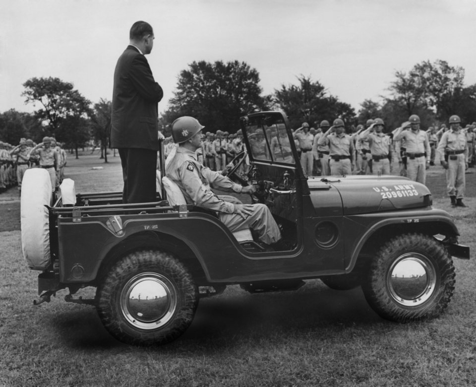 Photo - TROOPING THE LINE at Fort Chaffee, Ark., Saturday, Gov. Bellmon rides past ranks of saluting Thunderbirds at the traditional Governor's Day Parade.  Riding with Bellmon is Brig. Gen. Robert C. Dunnington, assistant commander of the 45th Infantry Division.  Staff photo by George Tapscott.  Photo undated and published on 08/11/1963 in The Daily Oklahoman (E).