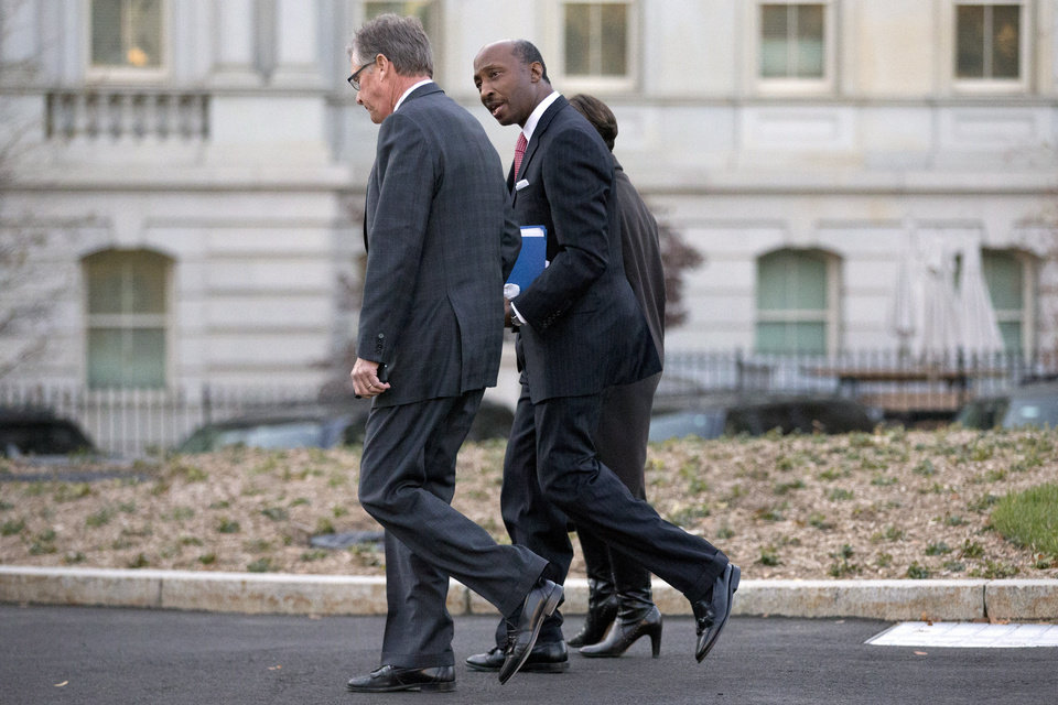 Caterpillar Inc. CEO Douglas Oberhelman, left, walks with Merck & Co. CEO Ken Frazier and Archer Daniels Midland CEO Patricia Woertz, obscured, as they arrive at the White House to attend a meeting of business leaders with President Barack Obama and Vice President Biden at the White House in Washington, Wednesday, Nov. 28, 2012. (AP Photo/Jacquelyn Martin)