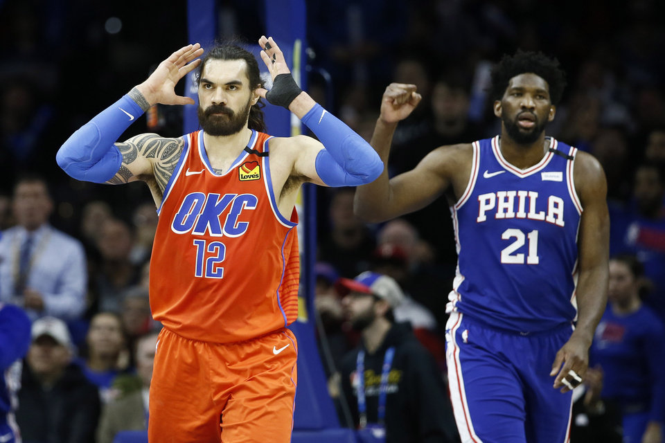 Photo - Oklahoma City Thunder's Steven Adams, left, reacts after a missed shot past Philadelphia 76ers' Joel Embiid during the second half of an NBA basketball game, Monday, Jan. 6, 2020, in Philadelphia. (AP Photo/Matt Slocum)