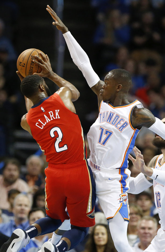 Photo - Oklahoma City's Dennis Schroder (17) defends New Orleans' Ian Clark (2) during an NBA basketball game between the Oklahoma City Thunder and the New Orleans Pelicans at Chesapeake Energy Arena in Oklahoma City, Monday, Nov. 5, 2018. Photo by Nate Billings, The Oklahoman