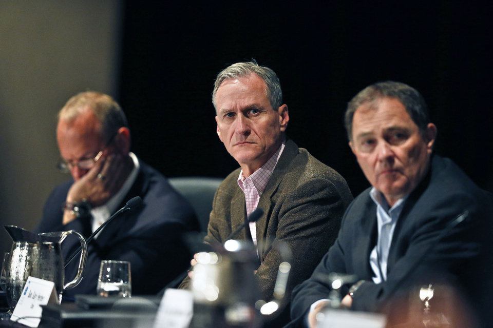 Photo - Governors Dennis Daugaard of South Dakota, center, Gary Herbert of Utah, right, and Matt Mead of Wyoming participate in a roundtable discussion titled Water in the West: Challenges and Opportunities, during the annual Western Governors' Association Meeting, at the Broadmoor Hotel in Colorado Springs, Tuesday, June 10, 2014. Ten governors from Western states attended the second day of the conference Tuesday, discussing common regional issues. (AP Photo/Brennan Linsley)