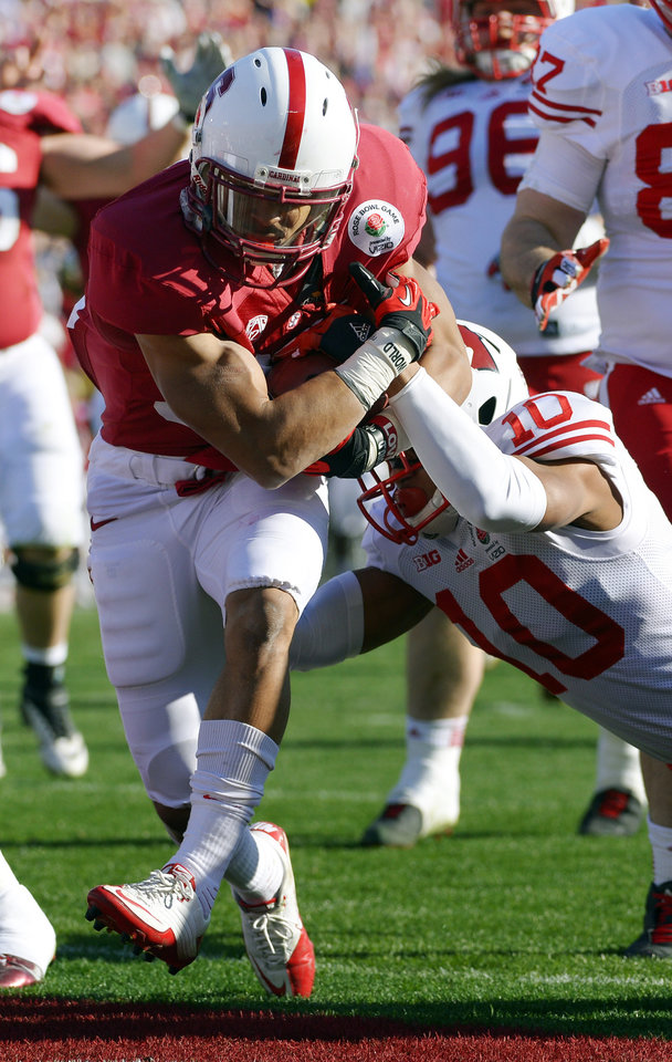 Photo - Stanford running back Kelsey Young rushes for a touchdown against Wisconsin defensive back Devin Smith during the first half of the Rose Bowl NCAA college football game, Tuesday, Jan. 1, 2013, in Pasadena, Calif. (AP Photo/Mark J. Terrill)