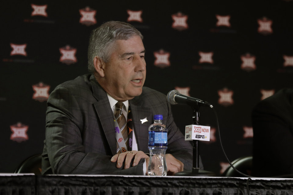 Photo - Big 12 commissioner Bob Bowlsby talks to the media after canceling the remaining NCAA college basketball games in the Big 12 Conference tournament due to concerns about the coronavirus Thursday, March 12, 2020, in Kansas City, Mo. The biggest conferences in college sports all canceled their basketball tournaments because of the new coronavirus, seemingly putting the NCAA Tournament in doubt. (AP Photo/Charlie Riedel)