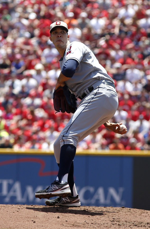Photo - Cleveland Indians starting pitcher Ubaldo Jimenez throws against the Cincinnati Reds in the first inning during a baseball game, Monday, May 27, 2013, in Cincinnati. (AP Photo/David Kohl)