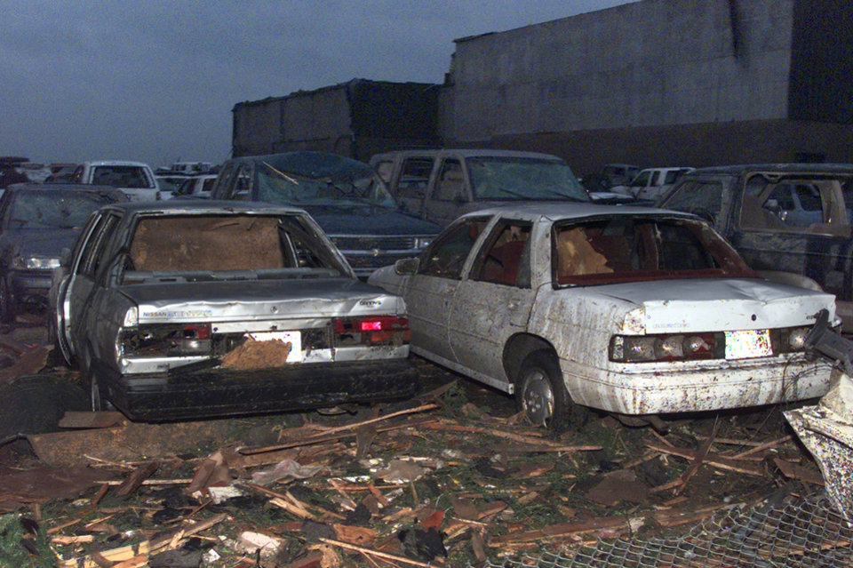 May 3, 1999, Oklahoma City Tornado:  Tornado damage: Cars in the parking lot of Westmoore High School show the damage from a tornado.  Staff Photo by Steve Sisney