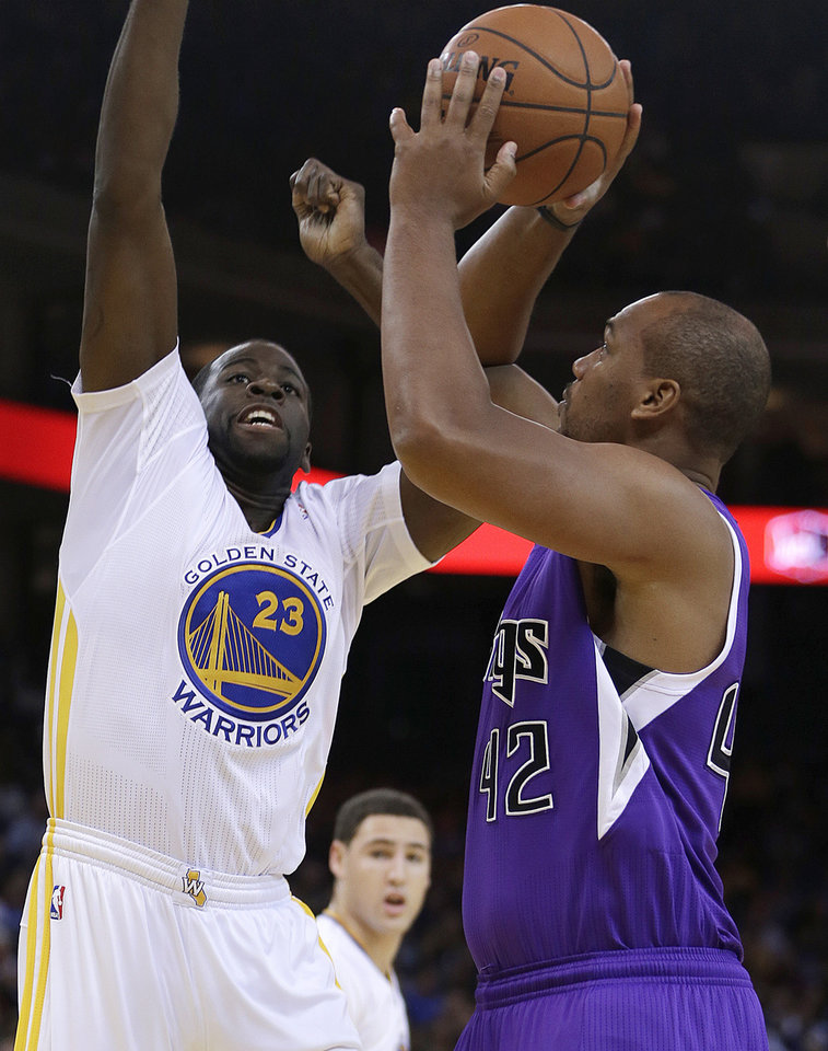 Photo - Sacramento Kings' Chuck Hayes, right, shoots against Golden State Warriors' Draymond Green during the first half of an NBA basketball game on Saturday, Nov. 2, 2013, in Oakland, Calif. (AP Photo/Ben Margot)