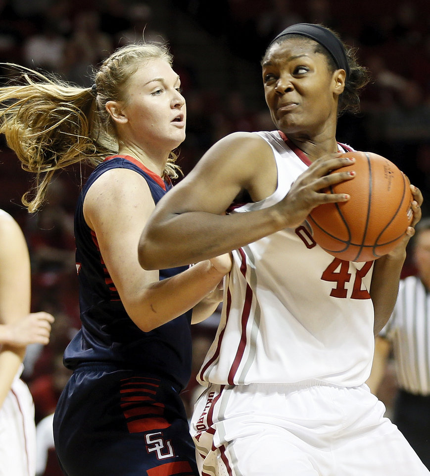 Photo - Oklahoma's Kaylon Williams (42) works against Samford's Ellen Riggins (22) during a women's college basketball game between the University of Oklahoma Sooners (OU) and the Samford Bulldogs at Lloyd Noble Center in Norman, Okla., Sunday, Dec. 29, 2013. Photo by Nate Billings, The Oklahoman