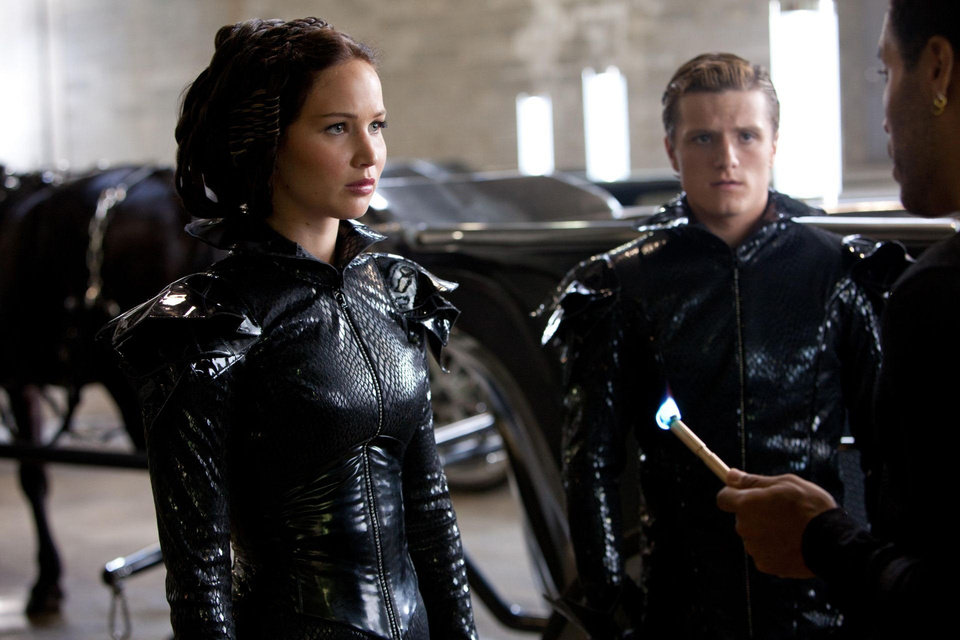 "Katniss Everdeen (Jennifer Lawrence, left), Peeta Mellark (Josh Hutcherson, center) and Cinna (Lenny Kravitz, right) in ""The Hunger Games."" PHOTO BY MURRAY CLOSE PROVIDED. <strong>Photo credit: Murray Close</strong>"