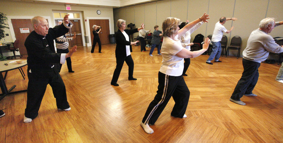 Photo - Instructor David Kamphaus, far left, leads a tai chi class for seniors at the Edmond Senior Center. PHOTO BY PAUL B. SOUTHERLAND, THE OKLAHOMAN.  PAUL B. SOUTHERLAND - THE OKLAHOMAN