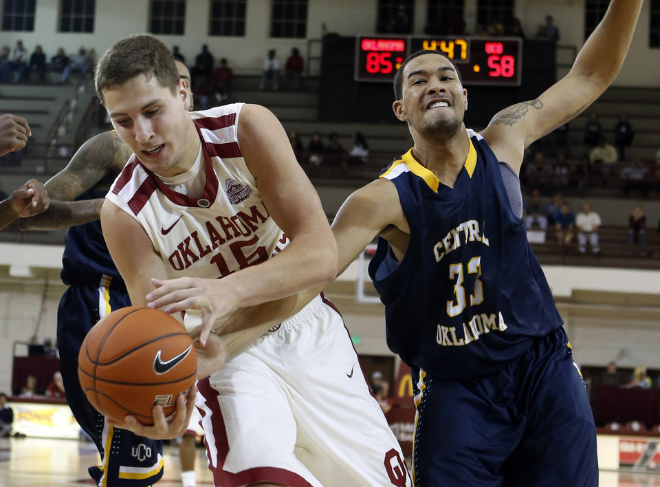 Oklahoma\'s Tyler Neal (15) and Seth Heckart (3) fight for the ball as the University of Oklahoma (OU) Sooners men\'s basketball team defeats the Central Oklahoma Bronchos 94-66 at McCasland Field House on Wednesday, Nov. 7, 2012 in Norman, Okla. Photo by Steve Sisney, The Oklahoman