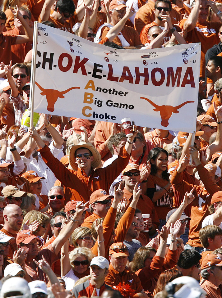 Photo - Texas fans celebrate the 16-13 win over Oklahoma during the Red River Rivalry college football game between the University of Oklahoma Sooners (OU) and the University of Texas Longhorns (UT) at the Cotton Bowl in Dallas, Texas, Saturday, Oct. 17, 2009. Photo by Chris Landsberger, The Oklahoman
