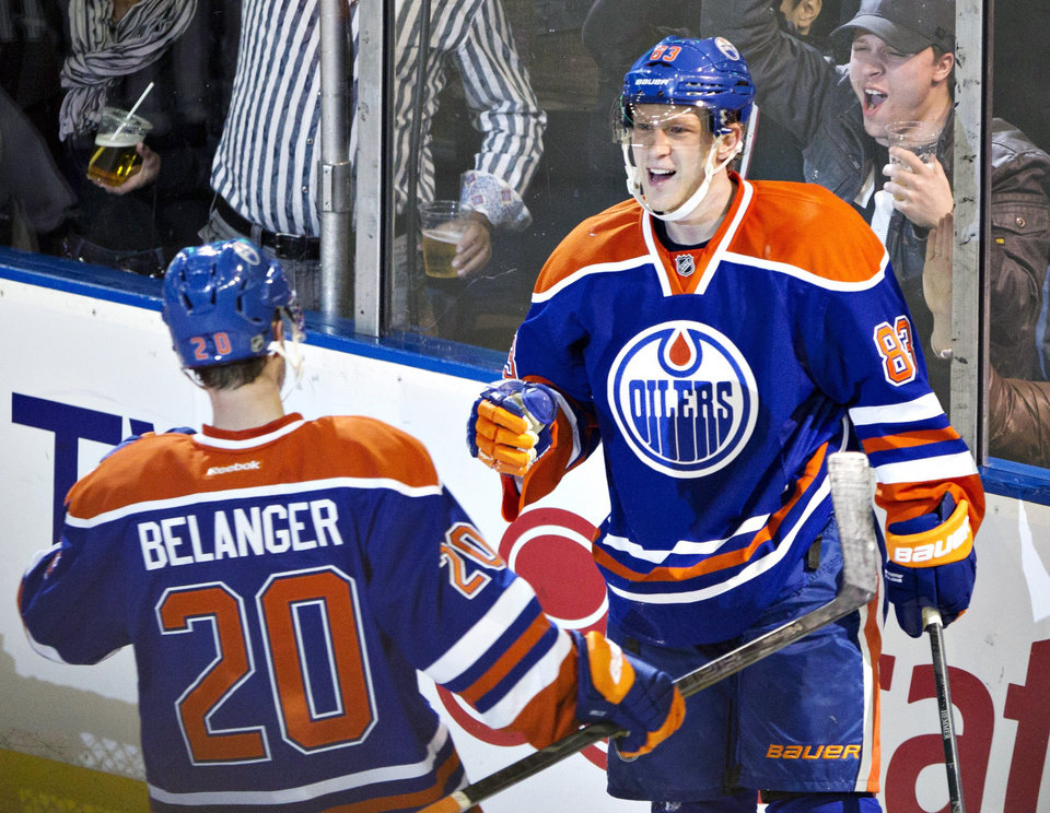 Photo - Edmonton Oilers' Eric Belanger, left, and Ales Hemsky, celebrate Hemsky's goal against the Colorado Avalanche during the second period of an NHL hockey game in Edmonton, Alberta, Saturday, Feb. 16, 2013. (AP Photo/The Canadian Press, Jason Franson)